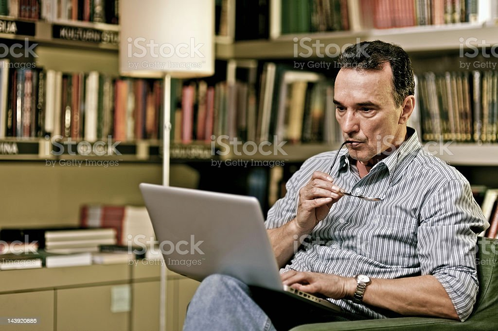 Mature adult  man with laptop royalty-free stock photo