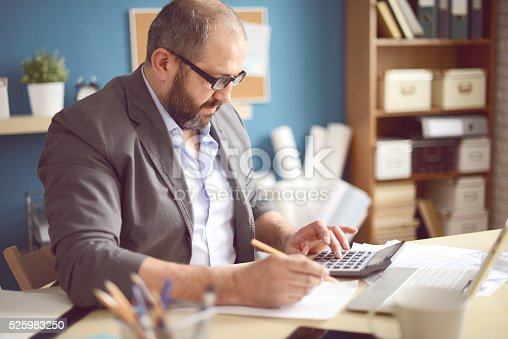 istock Mature Adult man working in the office 525983250