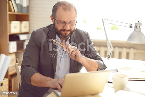 istock Mature Adult man working in the office 526552580