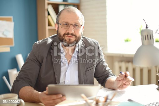 istock Mature Adult man working in the office 534220562