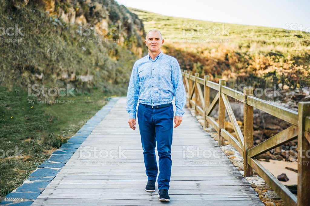 Mature adult walking stock photo