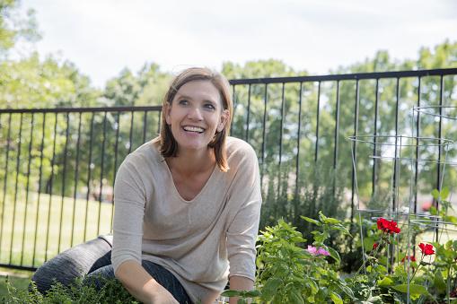 Mature adult woman gardening