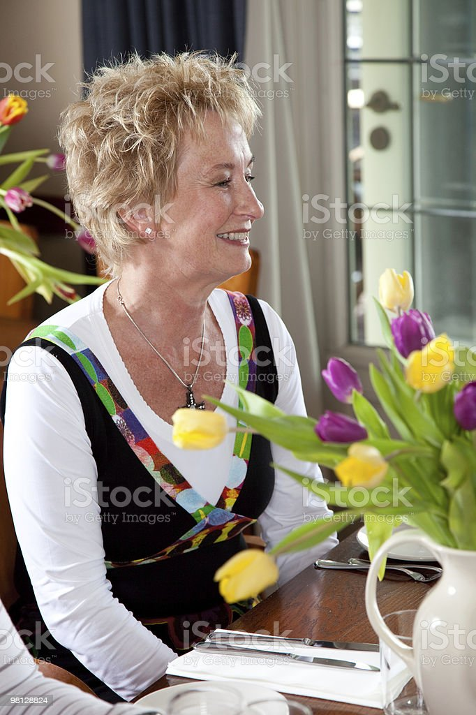 Mature adult woman having lunch royalty-free stock photo