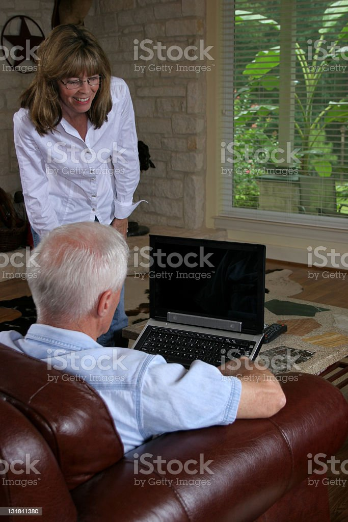 Mature adults discussing a laptop. royalty-free stock photo