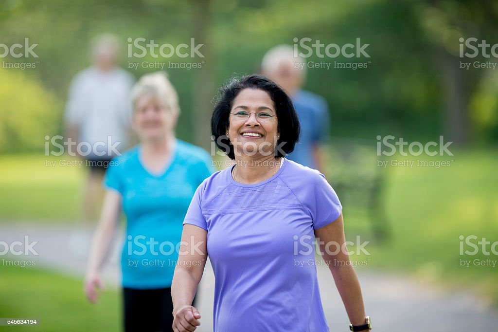 Mature Adults Walking on a Sunny Day stock photo