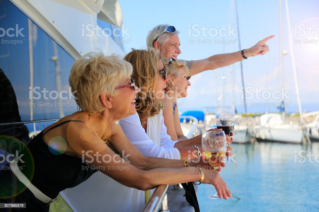 Mature adults watching the summer sky on a yacht stock photo