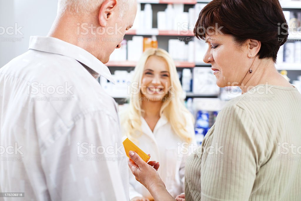 Mature adut couple at the pharmacy royalty-free stock photo
