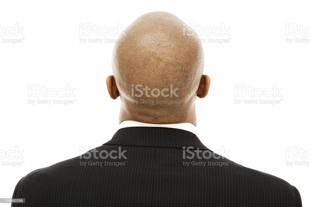 Mature African American business man bald head from behind suit stock photo