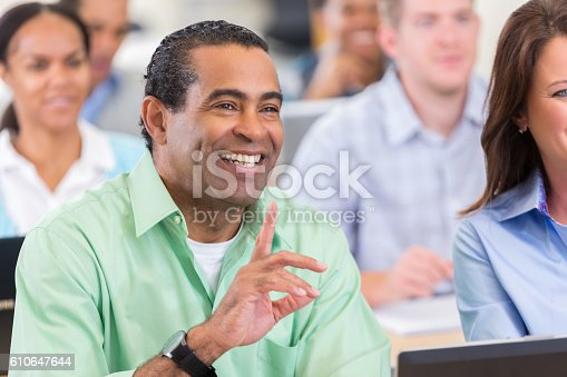 877026364 istock photo Mature African American businessman asks question during conference 610647644