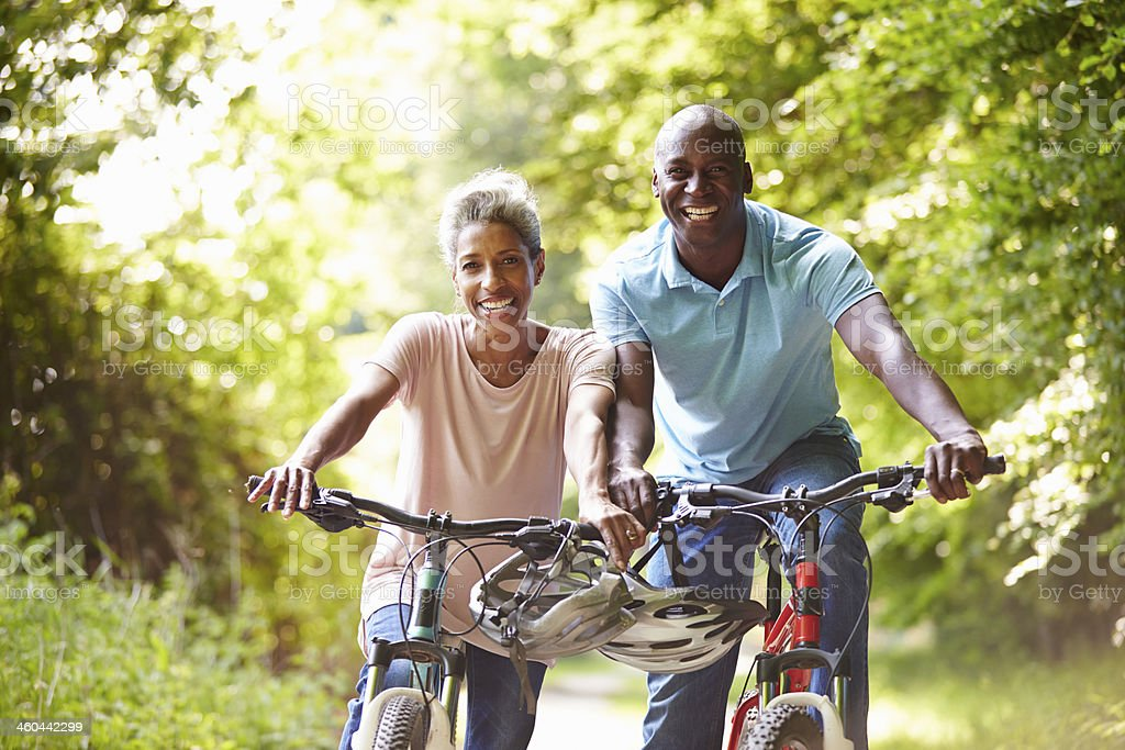 Mature African American Couple On Cycle Ride In Countryside stock photo