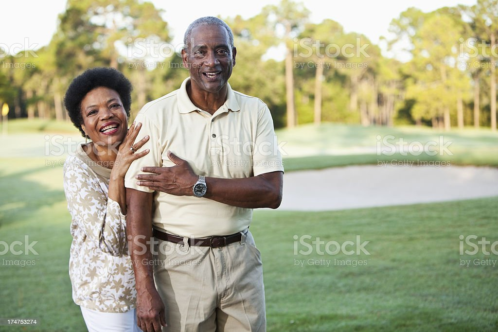 Mature African American couple on golf course royalty-free stock photo