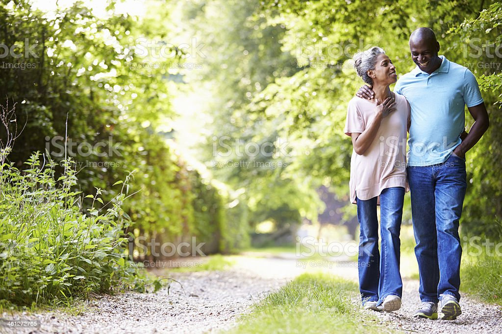Mature African American Couple Walking In Countryside stock photo