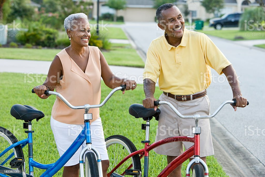 Mature African American couple with bicycles stock photo