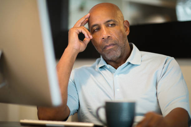 Mature African American man looking frustrated. stock photo