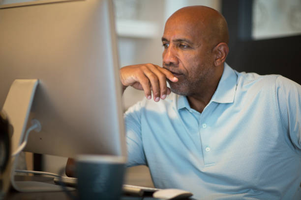 Mature African American man upset and looking concerened. stock photo