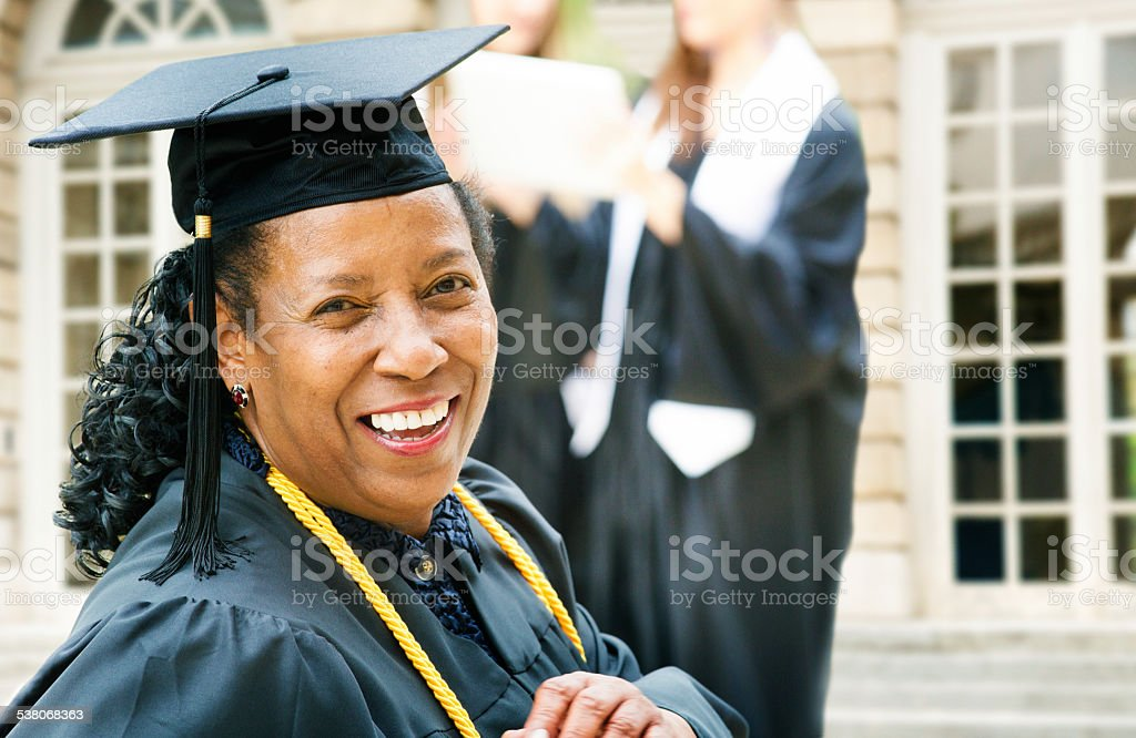 Mature African American woman on graduation day stock photo