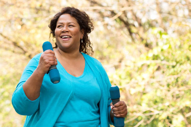 Mature African American woman smiling and exercising. stock photo