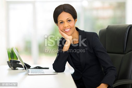 istock mature african businesswoman relaxing in office 515014797