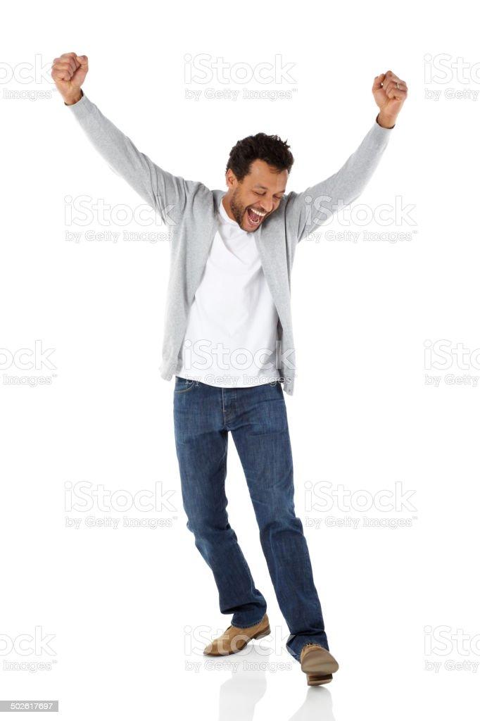 Mature african man celebrating success stock photo
