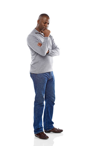 Mature african man thinking on white background stock photo