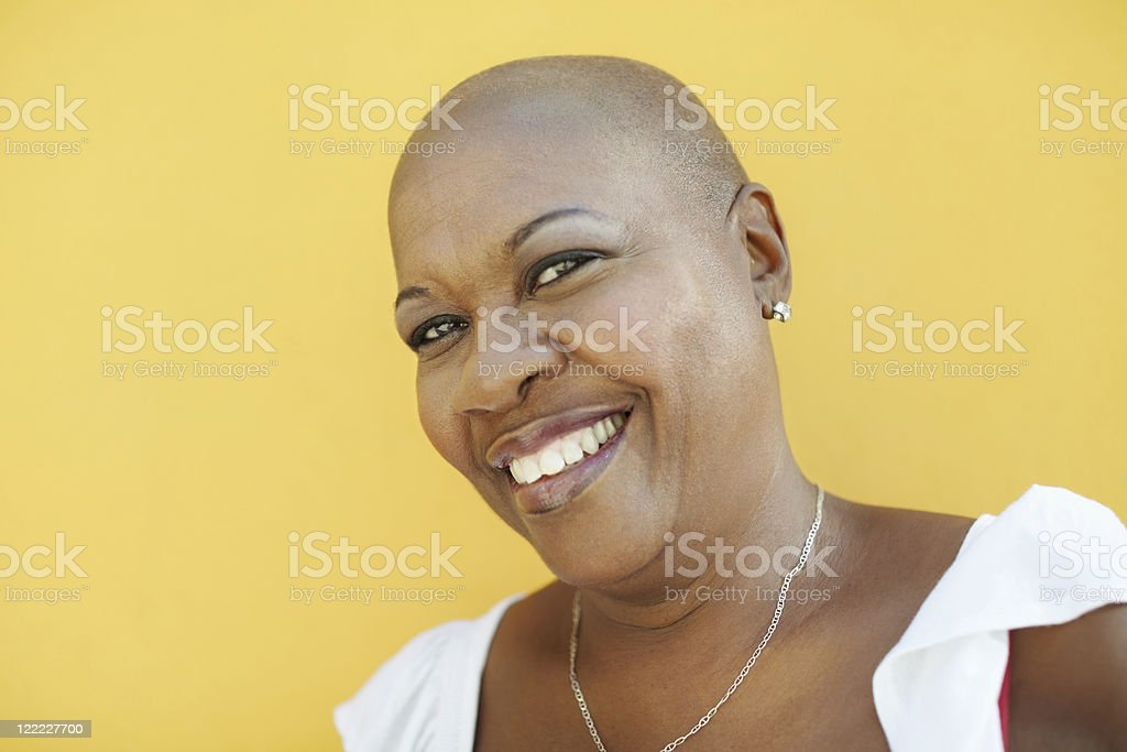 mature african woman smiling at camera stock photo