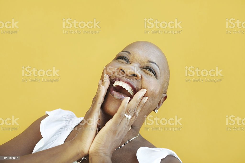 mature african woman smiling for joy stock photo