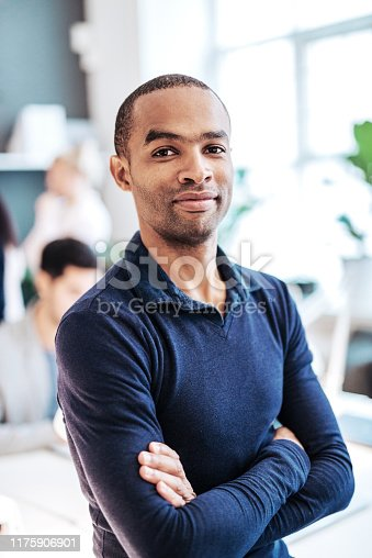 istock Mature African-American entrepreneur with arms crossed 1175906901