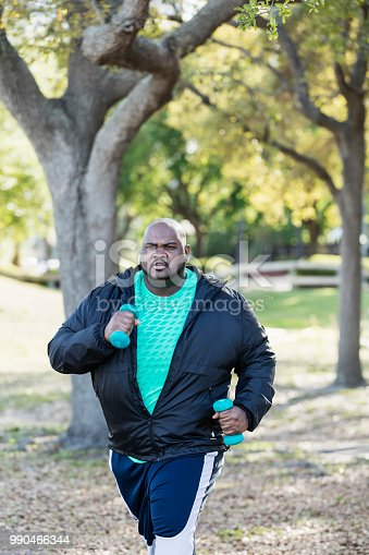 istock Mature African-American man exercising, jogging in park 990466344
