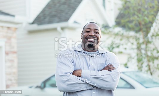 istock Mature African-American man standing outside home 1139540335