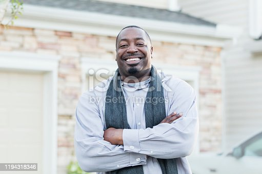 istock Mature African-American man standing outside home 1194318346