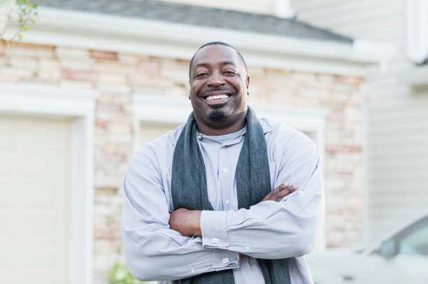Mature African-American man standing outside home stock photo
