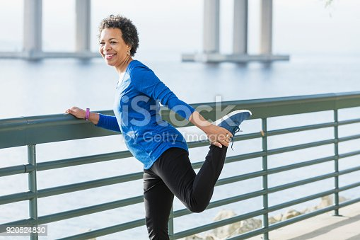 istock Mature African-American woman exercising on waterfront 920524830