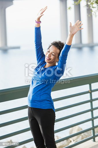 istock Mature African-American woman exercising on waterfront 920524832
