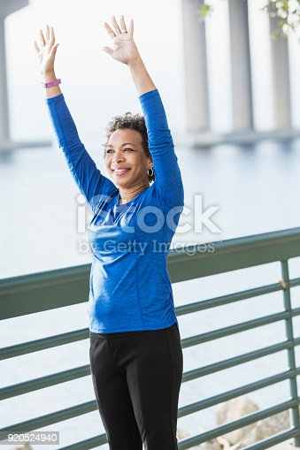 istock Mature African-American woman exercising on waterfront 920524940
