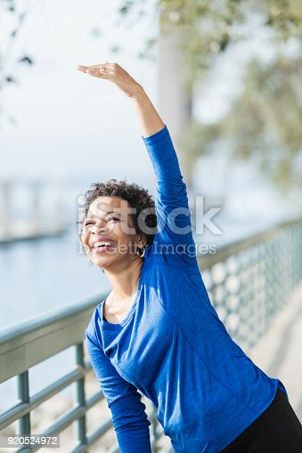 istock Mature African-American woman exercising on waterfront 920524972