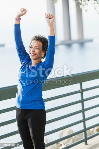 istock Mature African-American woman exercising on waterfront 950961812