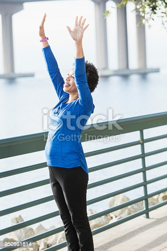 istock Mature African-American woman exercising on waterfront 950961814