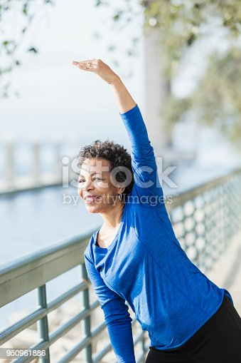 istock Mature African-American woman exercising on waterfront 950961886