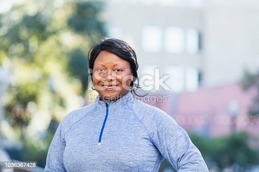 istock Mature African-American woman in city 1036367428