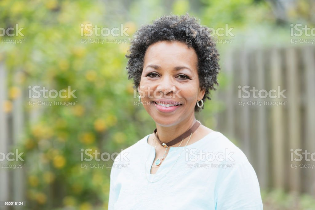 Mature African-American woman outdoors stock photo
