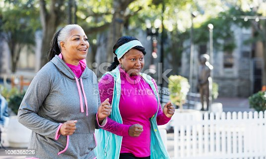 1036366486istockphoto Mature African-American women in city, exercising 1036365226