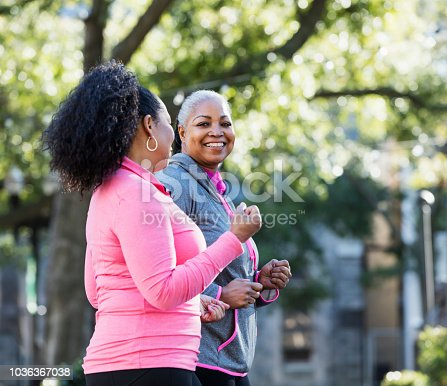1036366486istockphoto Mature African-American women in city, exercising 1036367038
