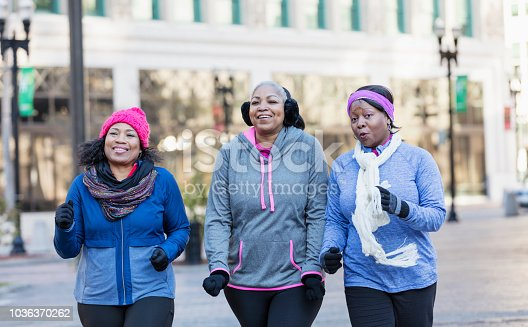 1036366486istockphoto Mature African-American women in city, exercising 1036370262