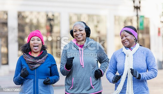 1036366486istockphoto Mature African-American women in city, exercising 1036370662