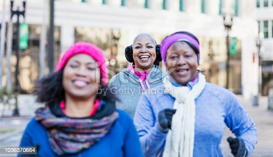 1036366486istockphoto Mature African-American women in city, exercising 1036370664