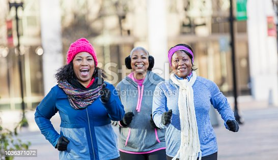 1036366486istockphoto Mature African-American women in city, exercising 1036371072