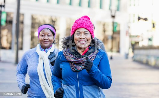 1036366486istockphoto Mature African-American women in city, exercising 1036371076
