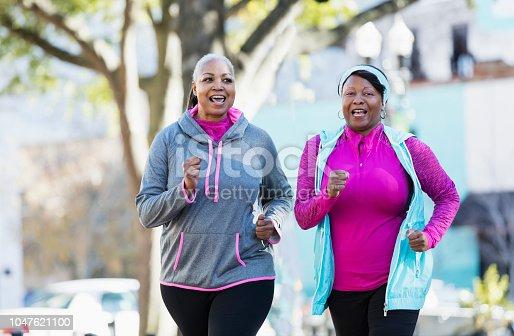 istock Mature African-American women in city, exercising 1047621100