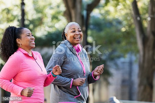 1036366486istockphoto Mature African-American women in city, exercising 1047621104
