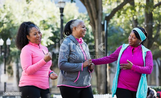 1036366486istockphoto Mature African-American women in city, exercising 1047622222